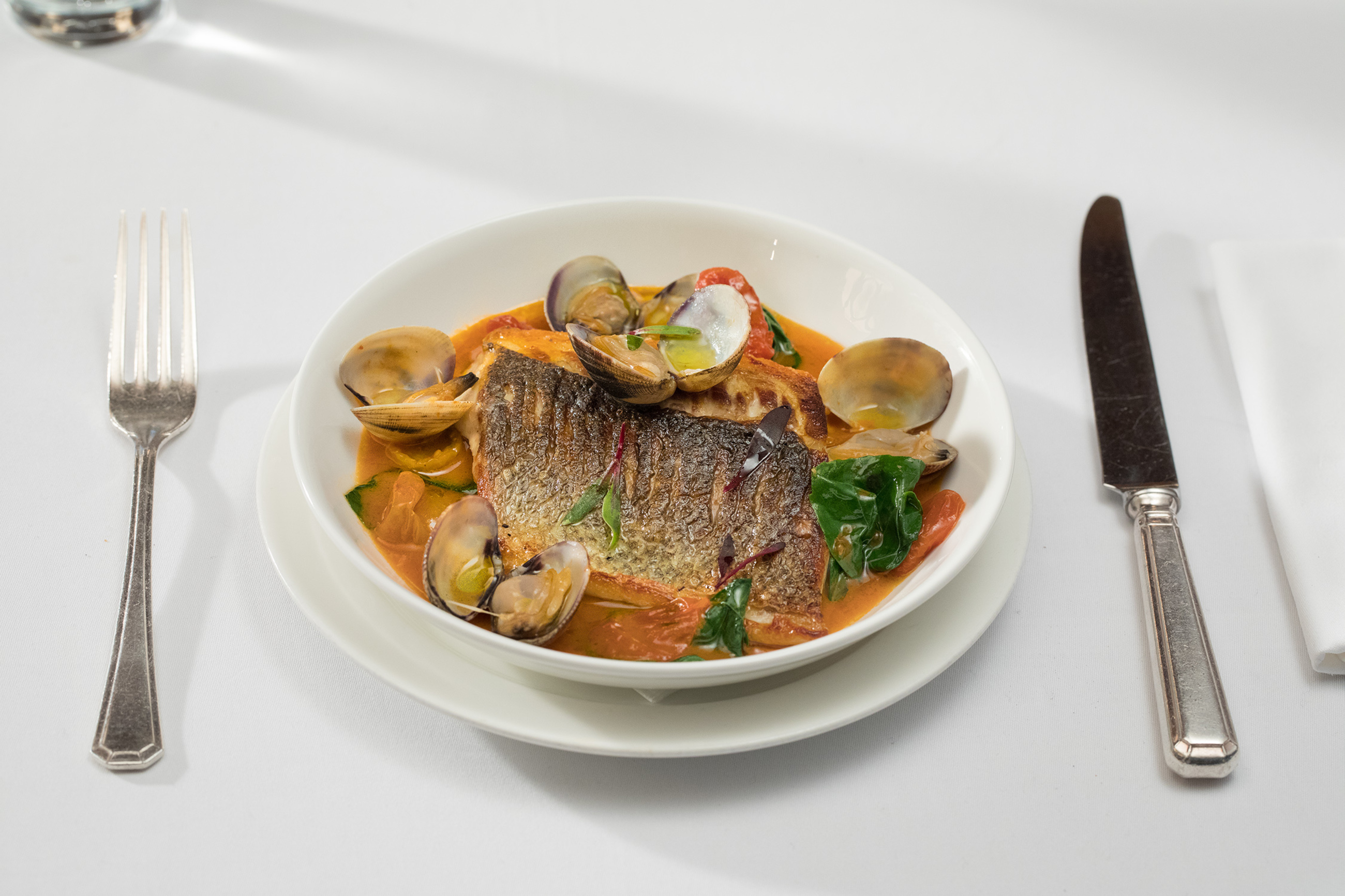 Sea bass, clams and tomato